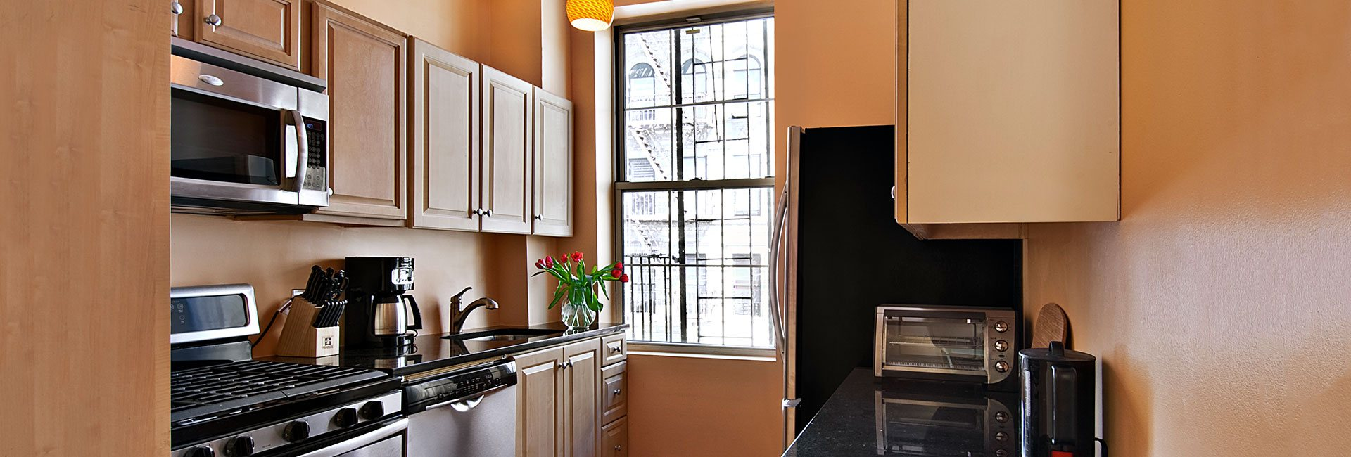 Kitchen in SOL Apartment New York
